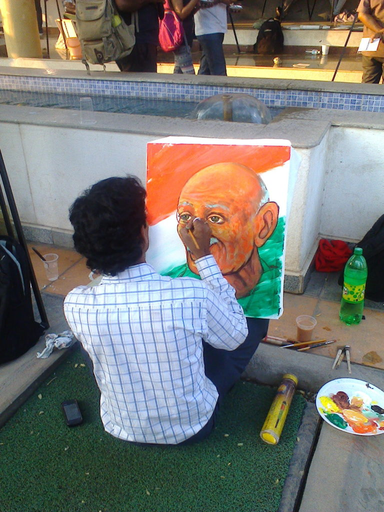 Gandhi being painted